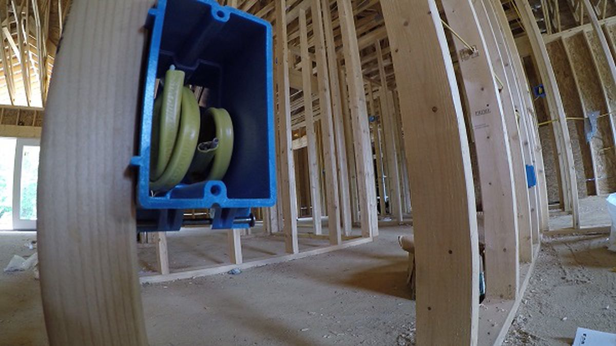 A home under construction in Lawrence County, Kentucky prepares to be wired for cable and internet services.