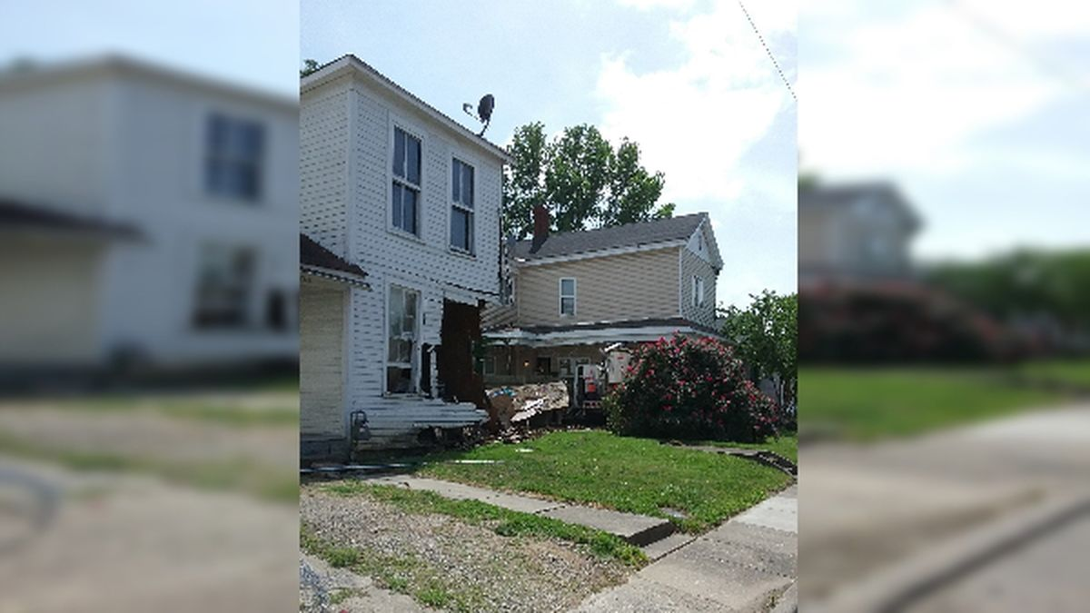 Two homes were severely damaged Saturday after a power company truck crashed into them.