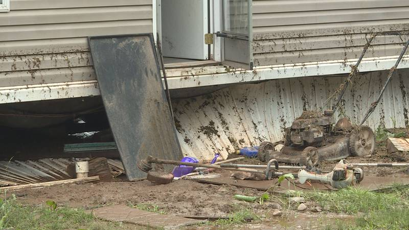 Amy White's house along Clay Lick Road is covered with mud after being flooded during Thursday...