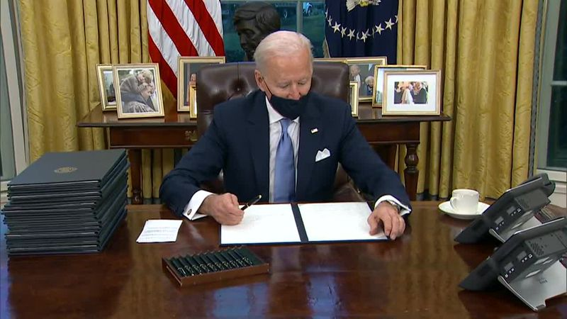 President Joe Biden signs multiple executive actions.