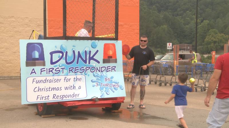 A child lines up his throw in an attempt to dunk a first responder at Pikeville Walmart
