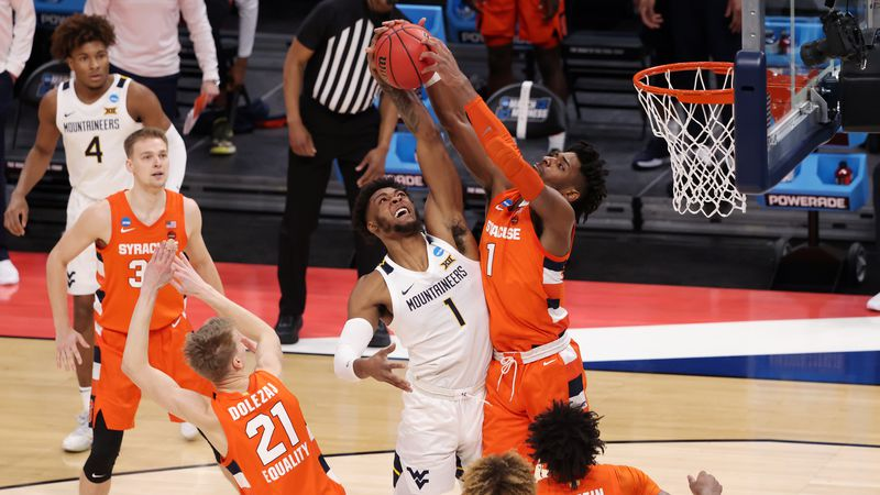 INDIANAPOLIS, IN - MARCH 21: Syracuse Orange against the West Virginia Mountaineers in the...