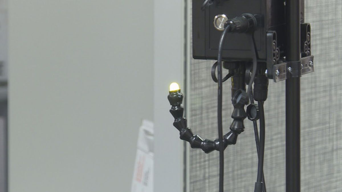 These new temperature gauges will be installed in Charleston city buildings. The light turns green for a normal temperature and red for a fever.
