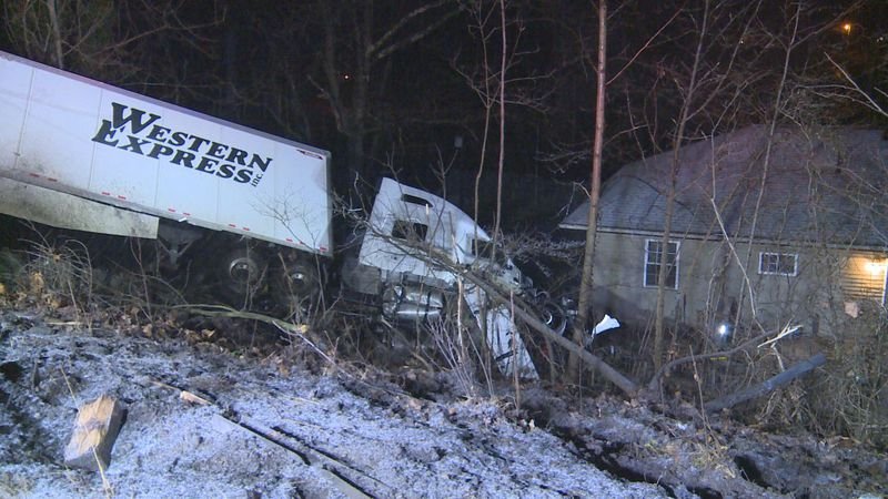 Officials with the Nitro Fire Department say a tractor-trailer slid off the road and onto a...