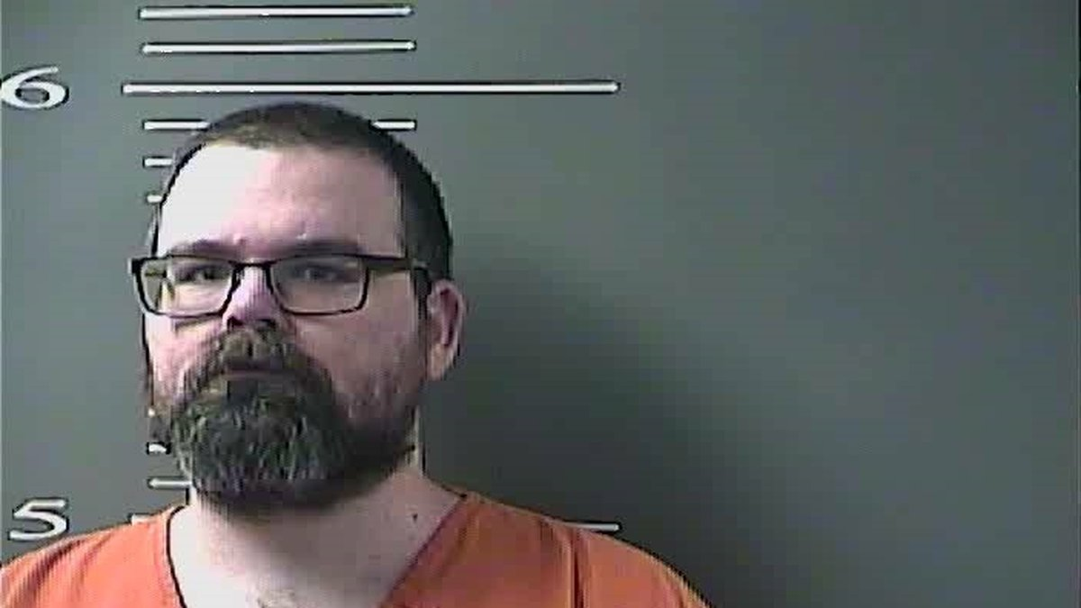 Phillip Adam Webb is facing several charges after police raid his home