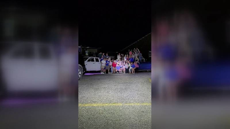 Students pose after they finish their senior prank Wednesday night.