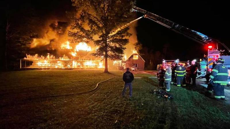 A family home and garage caught fire early Sunday morning.